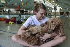 Churchill swimmer Ben Ownby holds his service dog, Dakota, before practice with the Alamo Area Aquatics club team at Josh Davis Natatorium in San Antonio on Tuesday, Jan. 29, 2013. Photo: Lisa Krantz, Express-News